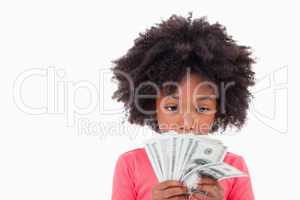 Girl looking at bank notes