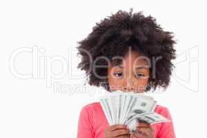 Girl looking at bank notes
