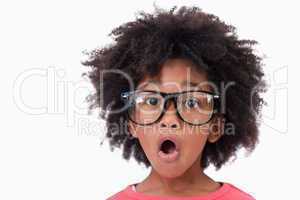 Close up of a shocked smart girl