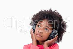 Close up of a quiet girl listening to music