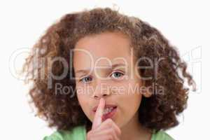 Close up of a girl asking for silence