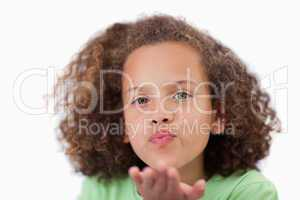 Close up of a girl blowing a kiss