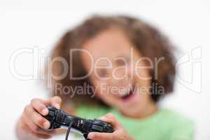 Smiling girl playing a video game