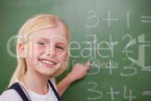 Blonde schoolgirl pointing at something