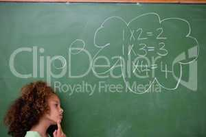 Schoolgirl thinking about algebra