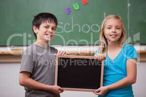 Pupils holding a school slate
