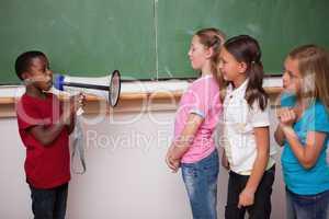 Schoolboy yelling through a megaphone to his classmates