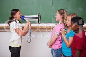 Schoolgirl yelling through a megaphone to her classmates