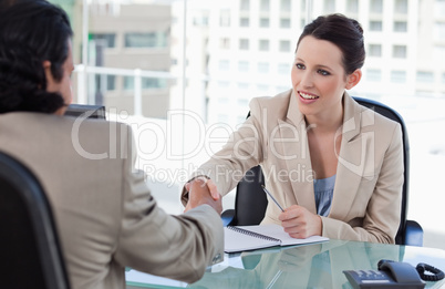 Manager shaking the hand of a male applicant