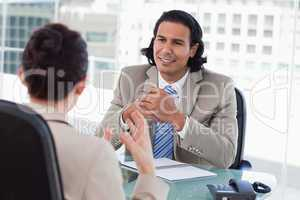 Happy manager interviewing a female applicant