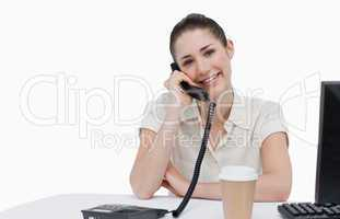 Smiling secretary answering the phone