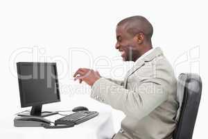 Angry businessman using a monitor
