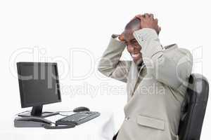 Furious businessman using a monitor