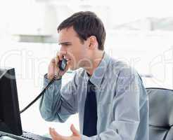 Irritated office worker on the phone