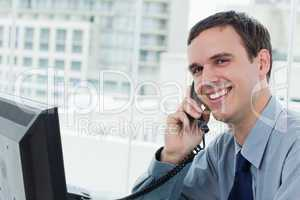 Happy office worker on the phone