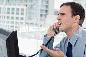 Confused office worker on the phone