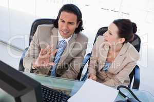 Focused business team using a computer