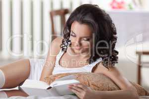young woman read book in morning interior