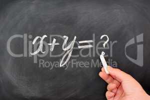 Question formula written on blackboard