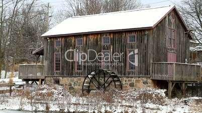 Old water mill in Waterloo, Ontario in snowy day.