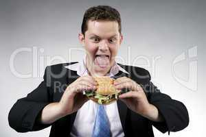Businessman anxious to eat his hamburger