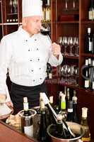 Chef cook taste wine glass in restaurant