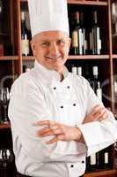 Chef cook confident professional posing restaurant
