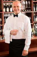 Wine bar waiter mature smiling in restaurant