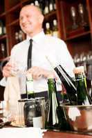 Wine bar bottles waiter in restaurant