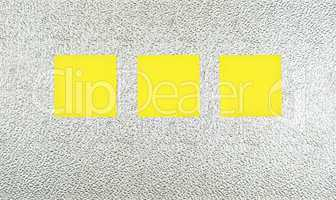 Three yellow notes on silver marbled metal plate