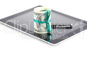 tablet,tube of dollars and stylus isolated on white