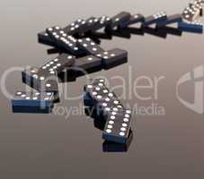 Dominoes collapsed on reflective surface
