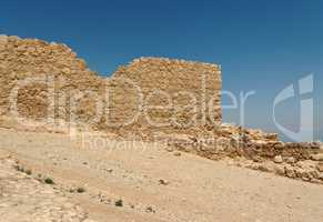 Jagged wall of ancient Masada fortress ruin in the desert near the Dead Sea