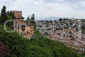 Bastions of Alhambra castle on the hill above the town of Granada, Spain