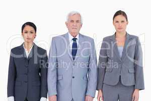 Three businesspeople standing