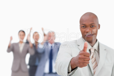 Salesman with team behind him giving approval