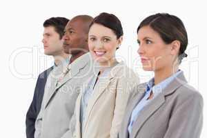 Smiling saleswoman standing between her associates