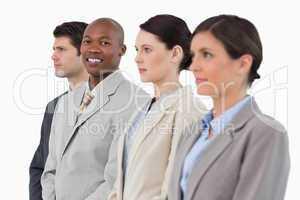 Smiling salesman standing between his associates