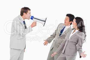 Salesman with megaphone shouting at associates