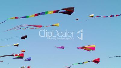 Kites flying against blue sky