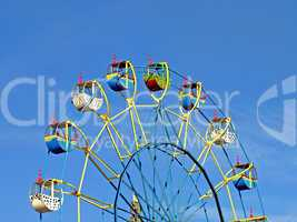 Color carousel against of the summer blue sky.