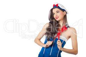 Beautiful sailor woman pulling her scarf
