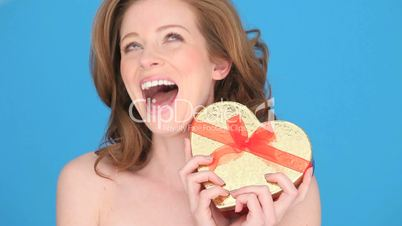 Smiling Woman Holding Heart-shaped Box