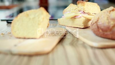 Preparing Mortadella Sandwich With Corn Bread
