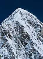 Himalayas: Pumori peak and blue sky