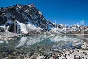 Sacred Lake and mountain near Gokyo in Himalayas