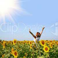 redhaired woman in sunflower field
