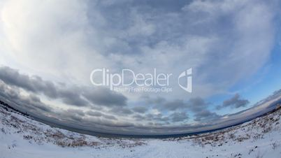 Clouds over the sea in winter with fisheye view (Time Lapse)