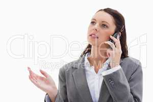 Close up of a businesswoman on the phone explaining
