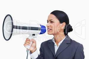 Close up of saleswoman using megaphone